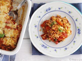 Farro gratinato con pomodorini, emmental e rucola